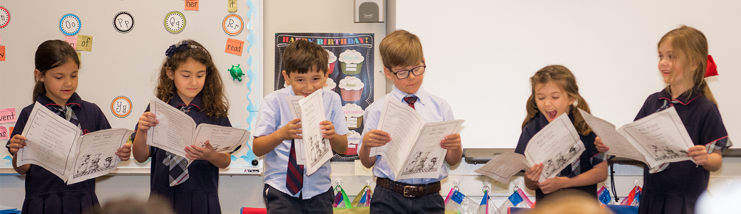 students reading in Lower School